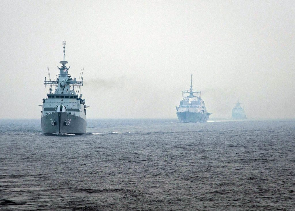 HF95BN The Royal Malaysian Navy guided-missile frigate KD Jebat (FFG 29) is followed by the littoral combat ship USS Freedom (LCS 1) and the offshore patrol vessel KD Kelantan as part of Cooperation Afloat Readiness and Training (CARAT) Malaysia 2013. More than 1,200 sailors and Marines are participating in CARAT. CARAT is a series of bilateral military exercises between the U.S. Navy and the armed forces of Bangladesh, Brunei, Cambodia, Indonesia, Malaysia, the Philippines, Singapore, Thailand and Timor Leste. (U.S. Navy photo by Mass Communication Specialist 3rd Class Karolina A. Oseguera/Released)